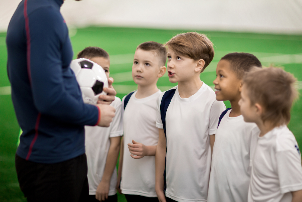 Boy talking to trainer